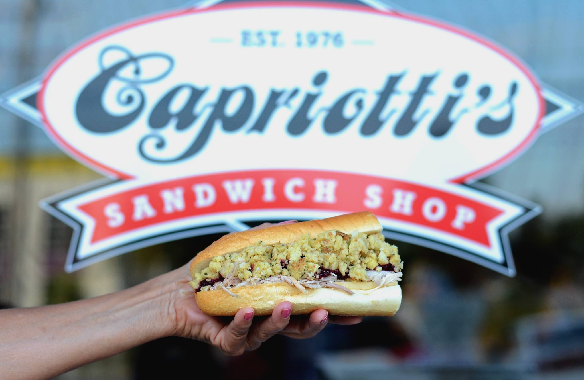 Capriotti's logo with a sandwich