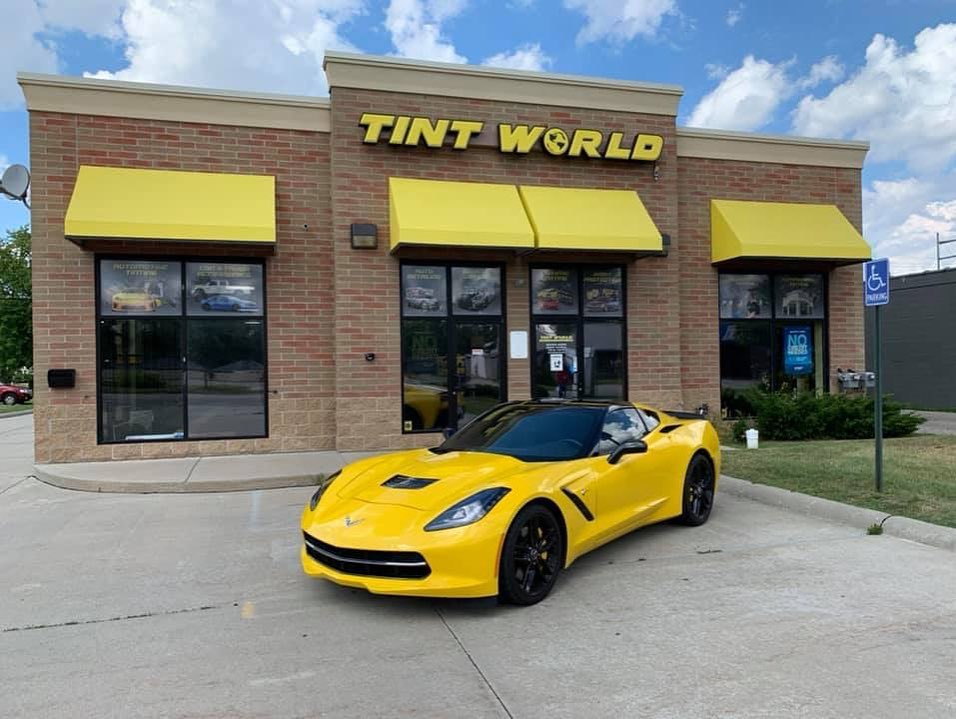 Tint World Location with yellow car on the outside